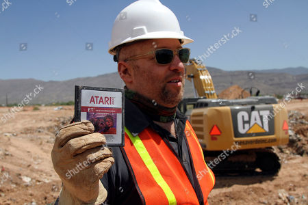 "Zak Penn Film director Zak Penn shows a box of a decades-old Atari 'E.T. the Extra-Terrestrial' game found in a dumpsite in Alamogordo, N.M. Joe Lewandowski, a consultant for the film companies that documented the dig, says the online auction of 100 Atari games, which ended, generated $37,000. The ""E.T."" game, still in its original box, sold for $1,537"