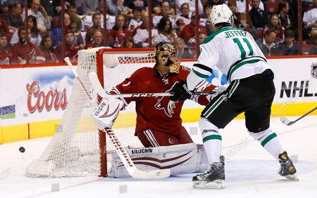 Stock Image of Dustin Jeffrey, Thomas Greiss Phoenix Coyotes' Thomas Greiss (1), of Germany, makes a save on a shot by Dallas Stars' Dustin Jeffrey (11) during the second period of an NHL hockey game, in Glendale, Ariz. The Coyotes defeated the Stars 2-1