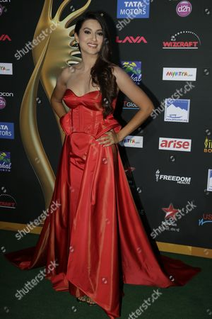 Stock Image of Gauhar Khan Indian actess and model Gauhar Khan poses for photographers as she walks the green carpet for 15th annual International Indian Film Awards, in Tampa, Fla