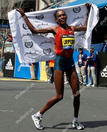 Rita Jeptoo Rita Jeptoo, of Kenya, celebrates her win in the women's division of the 118th Boston Marathon, in Boston