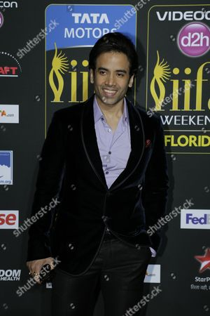 Stock Image of Tusshar Kapoor poses for photographers as he walks the green carpet for the 15th annual International Indian Film Awards, in Tampa, Fla