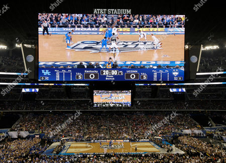 Julius Randle, Phillip Nolan Kentucky forward Julius Randle and Connecticut forward Phillip Nolan tip the ball to start the NCAA Final Four tournament college basketball championship game, in Arlington, Texas