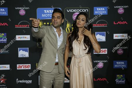Abhay Deol, left, poses with Preeti Desai poses for photographers as they walks the green carpet for 15th annual International Indian Film Awards, in Tampa, Fla