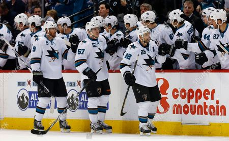 Stock Picture of Dan Boyle, Tommy Wingels, Marty Havlat San Jose Sharks defenseman Dan Boyle, front right, is congratulated after scoring a goal as teammates Marty Havlat, of the Czech Republic, front left, and Tommy Wingels follow past the team box while facing the Colorado Avalanche in the second period of an NHL hockey game in Denver on