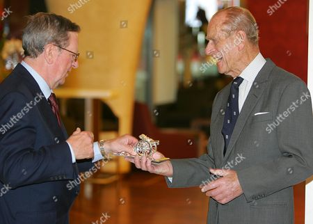 Arsenal Chairman Peter Hill-Wood presents Prince Philip with a gift as he officially opens the Emirates Stadium.
