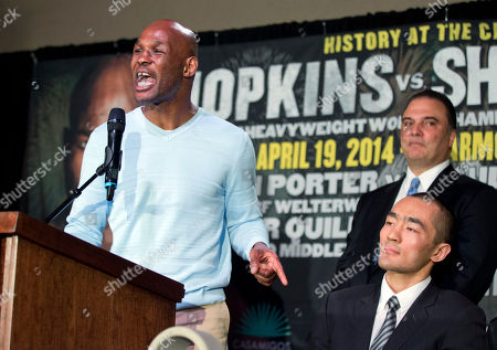 Bernard Hopkins, Beibut Shumenov, Richard Schaefer IBF light heavyweight boxing champion Bernard Hopkins, left, speaks during a news conference in Washington, on his 175-pound unification fight against WBA and IBA light heavyweight boxing champion Beibut Shumenov, front right, of Kazakhstan, to be held at the DC Armory in Washington on April 19. Promoter Richard Schaefer, back right, looks on