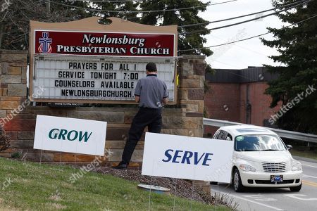 Mike Kane Mike Kane, a parishioner at the Newlonsburg Presbyterian Church in Murrysville, Pa., works on a sign outside his church that neighbors with the Franklin Regional School District campaus, where several people were stabbed at Franklin Regional High School, in Murrysville, Pa., near Pittsburgh. The suspect, a male student, was taken into custody and being questioned