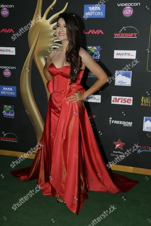Gauhar Khan Indian actess and model Gauhar Khan poses for photographers as she walks the green carpet for 15th annual International Indian Film Awards, in Tampa, Fla