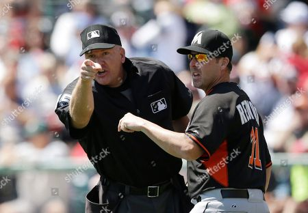 Jeff Nelson, Mike Redmond Home plate umpire Jeff Nelson stands next to Miami manager Mike Redmond as he points to Marlines third base coach Brett Butler during the first inning of a spring exhibition baseball game in Kissimmee, Fla., . Butler was disputing a call by Nelson