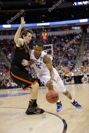 Duke forward Rodney Hood (5) moves against Mercer forward Bud Thomas (5) during the first half of an NCAA college basketball second-round game, in Raleigh, N.C