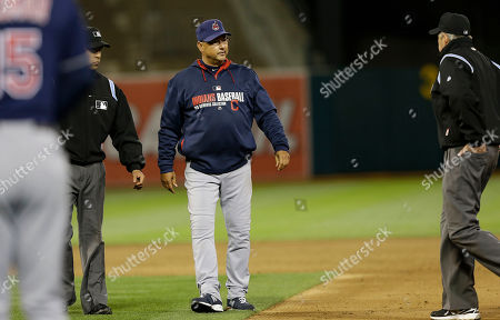 Terry Francona, Mike Winters, Mark Wegner Cleveland Indians manager Terry Francona, center, stands between umpire Mark Wegner, left, and umpire Mike Winters to challenge Mike Aviles being called out stealing second against the Oakland Athletics during the sixth inning of a baseball game in Oakland, Calif., . Aviles was initially called out at second base but was ruled safe after manager Terry Francona challenged the ruling and umpires reversed the call