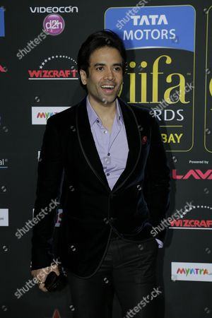 Tusshar Kapoor poses for photographers as he walks the green carpet for the 15th annual International Indian Film Awards, in Tampa, Fla