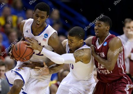Marcus Lewis, Andrew Wiggins, Frank Mason Kansas' Frank Mason, center, tries to hand a ball to teammate Andrew Wiggins, left, as Eastern Kentucky's Marcus Lewis watches during the first half of a second-round game in the NCAA college basketball tournament, in St. Louis