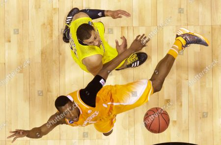 Josh Richardson, Jordan Morgan Tennessee's Josh Richardson and Michigan's Jordan Morgan go after a loose ball during the first half of an NCAA Midwest Regional semifinal college basketball tournament game, in Indianapolis