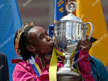 Rita Jeptoo of Kenya kisses the trophy after winning the women's division of the 118th Boston Marathon in Boston. Never before have Kenya's fabulously successful runners gone to the Olympics in such a negative light. Kenya has a doping problem, no doubt, but it's seemingly not on the same scale as Russia. At least 40 Kenyan track and field athletes have failed doping tests and been banned since the 2012 Olympics in London. That's an alarming rate of nearly one a month. Although 40 doping cases in four years is a significant number, the vast majority so far have been lower-level runners who haven't won major titles. There are a couple of exceptions: Marathon champion Jeptoo and two-time cross-country world champion Emily Chebet are among those banned