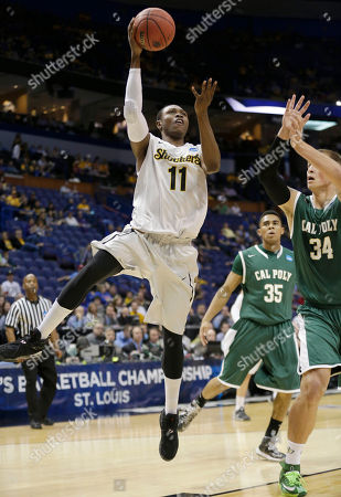 Stock Image of Cleanthony Early, Brian Bennett Wichita State forward Cleanthony Early (11) shoots as Cal Poly forward Brian Bennett (34) defends during the first half of a second-round game in the NCAA college basketball tournament, in St. Louis