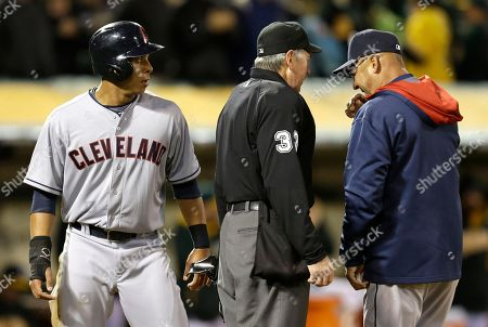 Terry Francona, Michael Brantley, Mike Winters Cleveland Indians' Michael Brantley, left, watches as manager Terry Francona, right, speaks with umpire Mike Winters in the sixth inning of a baseball game against the Oakland Athletics, in Oakland, Calif. Francona is contesting a play at the plate where Brantley was tagged out