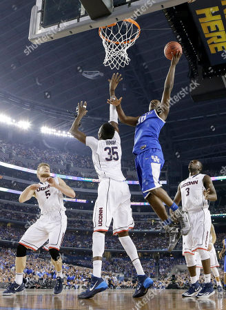 Niels Giffey, Amida Brimah, Julius Randle, Terrence Samuel Kentucky forward Julius Randle (30) shoots over Connecticut center Amida Brimah (35) as Niels Giffey (5) and Terrence Samuel (3) look on during the first half of the NCAA Final Four tournament college basketball championship game, in Arlington, Texas