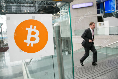 Bitcoin A man arrives for the Inside Bitcoins conference and trade show in New York. An Australian man long thought to be associated with the digital currency Bitcoin has publicly identified himself as its creator. BBC News said that Craig Wright told the media outlet he is the man previously known by the pseudonym Satoshi Nakamoto. The computer scientist, inventor and academic says he launched the currency in 2009 with the help of others
