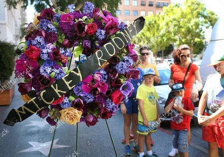 """Mickey Rooney Tourists from Australia stand by a memorial wreath on the Hollywood Walk of Fame star of Hollywood legend, Mickey Rooney, on Vine Street, in the Hollywood section of Los Angeles. The iconic actor, Rooney, died at 93 on Sunday, April 6, 2014. Over a four-decade span, he was nominated for four Academy Awards, and received two special Oscars for film achievements, won an Emmy for his TV movie """"Bill"""" and had a Tony nomination for his Broadway smash """"Sugar Babies"""