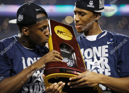 Terrence Samuel, Ryan Boatright Connecticut guard Terrence Samuel, left, and guard Lasan Kromah hold the championship trophy after beating Kentucky 60-54, at the NCAA Final Four tournament college basketball championship game, in Arlington, Texas