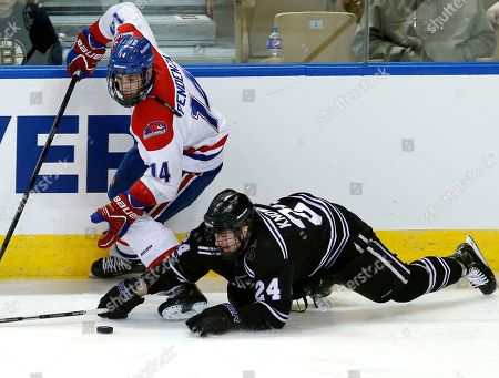 Stock Photo of Brett Knowles, Joseph Pendenza Minnesota State, Mankato's Brett Knowles (24) dives to control the puck against UMass Lowell's Joseph Pendenza (14) during the third period of an NCAA Northeast Regional hockey game in Worcester, Mass., . UMass Lowell won 2-1