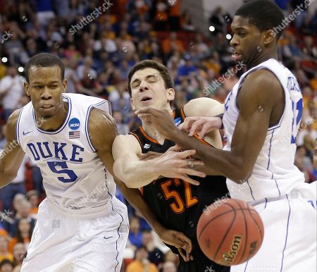 Mercer forward Daniel Coursey (52) passes the ball against Duke forward Rodney Hood (5) during the second half of an NCAA college basketball second-round game, in Raleigh, N.C