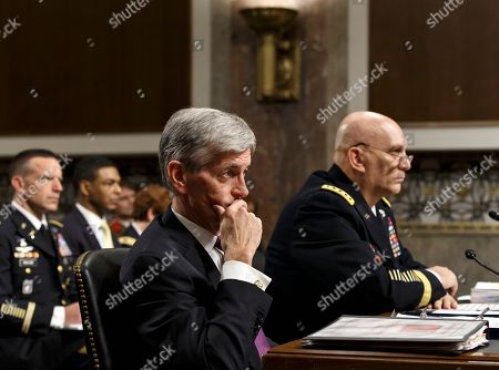 John M. McHugh, Raymond Odierno Army Secretary John M. McHugh, left, and Army Chief of Staff Gen Raymond Odierno update members of the Senate Armed Services Committee about the deadly shooting rampage by a soldier yesterday at Fort Hood in Texas, on Capitol Hill in Washington. An Iraq War veteran being treated for mental illness was the gunman who opened fire at Fort Hood, killing three people and wounding 16 others before committing suicide, in an attack on the same Texas military base where more than a dozen people were slain in 2009