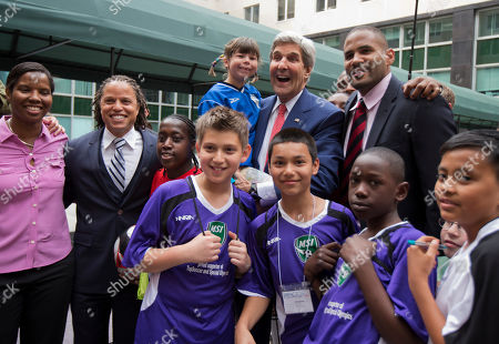 John Kerry, Cobi Jones Secretary of State John Kerry, back second from right, poses with young soccer players during a soccer clinic at the State Department in Washington, . Standing second from left is Cobi Jones, State Department's sports envoy
