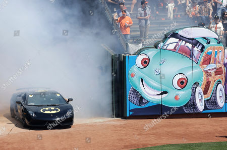 The Batmobile drives into AT&T Park with Miles Scott, dressed as Batkid, who threw out the ceremonial first pitch before an opening day baseball game between the San Francisco Giants and the Arizona Diamondbacks in San Francisco, . On Nov. 15, 2013, Scott, a Northern California boy with leukemia, fought villains and rescued a damsel in distress as a caped crusader through The Greater Bay Area Make-A-Wish Foundation