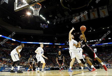 Stock Image of Elfrid Payton, Ethan Wragge Louisiana Lafayette's Elfrid Payton (2) goes up for a shot as Creighton's Ethan Wragge (34) defends during the second half of a second-round game in the NCAA college basketball tournament, in San Antonio. Creighton won 76-66