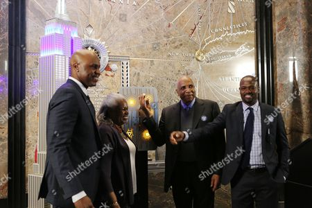 Stock Image of Cliff Floyd, Sharon Robinson, Frank Robinson, Harold Reynolds MLB Network analyst Cliff Floyd, Sharon Robinson, daughter of Jackie Robinson, Frank Robinson, the first African-American manager in baseball history, and MLB Network analyst Harold Reynolds, from left to right, are shown during a lighting ceremony at the Empire State Building in honor of Jackie Robinson Day, in New York City