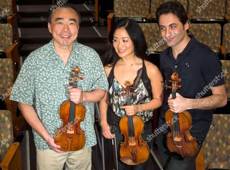 """Stock Picture of Cho-Liang Lin, Chee-Yun, Philippe Quint In this Thursday, March, 27, 2014 photo, three Stradivarius violins are displayed, from left, Taiwanese American Cho-Liang Lin, with the 1715 """"Titian,"""" South Korean Chee-Yun, with the 1714 """"Leonora Jackson,"""" Russian-American Philippe Quint with the 1708 """"Ruby,"""" after a rehearsal at the Colburn School in Los Angeles. The violins of Antonio Stradivari, arguably the most famous instruments ever created, have an almost mystical reputation for beauty and heavenly tone. This week eight of them have been brought together in the City of Angels """"Strad Fest LA"""