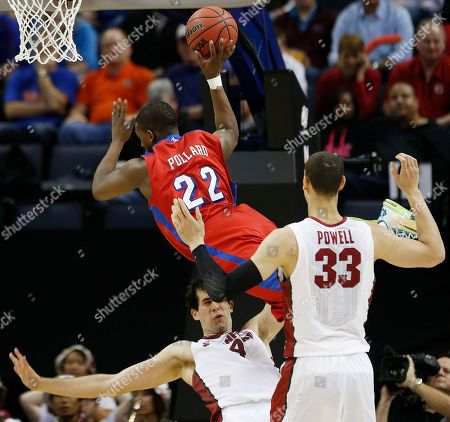 Dayton forward Kendall Pollard (22) shoots against Stanford's Stefan Nastic (4) and Dwight Powell (33) during the first half in a regional semifinal game at the NCAA college basketball tournament, in Memphis, Tenn