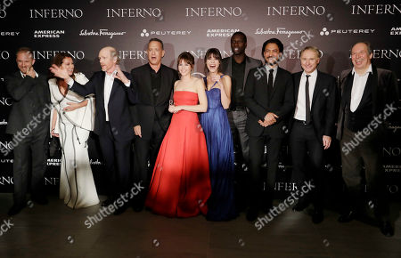 From left, screenwriter David Koepp, Ben Foster, Sidse Babett Knudsen, director Ron Howard, Tom Hanks, Ana Ularu, Felicity Jones, Omar Sy, Irrfan Khan, writer Dan Brown and composer Hans Zimmer, pose for a group photo at the premiere of the movie 'Inferno', based on a novel by Dan Brown, at the opera house in Florence, Italy