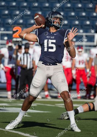 Nevada quarterback Tyler Stewart throws against Fresno State in the first quarter of an NCAA college football game in Reno, Nev