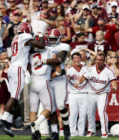 Stock Image of Vinnie Sunseri, John Fulton, Jeoffrey Pagan Alabama defensive back Vinnie Sunseri (3) celebrates after returning an interception 73-yards for a touchdown against Texas A&M with teammates John Fulton (10), Jeoffrey Pagan (8) during the third quarter of an NCAA college football game, in College Station, Texas