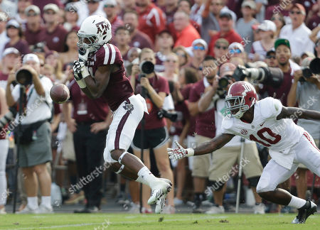Stock Photo of Darel Walker, John Fulton Texas A&M's Darel Walker, left, drops a pass as Alabama's John Fulton (10) defends during the third quarter of an NCAA college football game, in College Station, Texas
