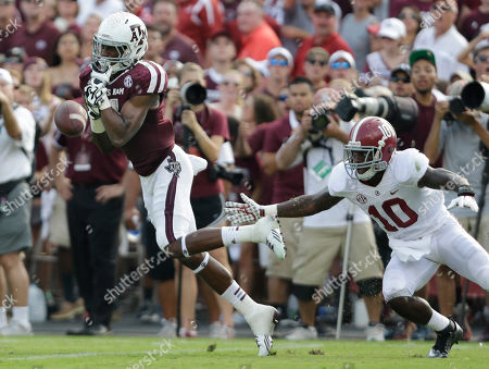 Darel Walker, John Fulton Texas A&M's Darel Walker, left, drops a pass as Alabama's John Fulton (10) defends during the third quarter of an NCAA college football game, in College Station, Texas