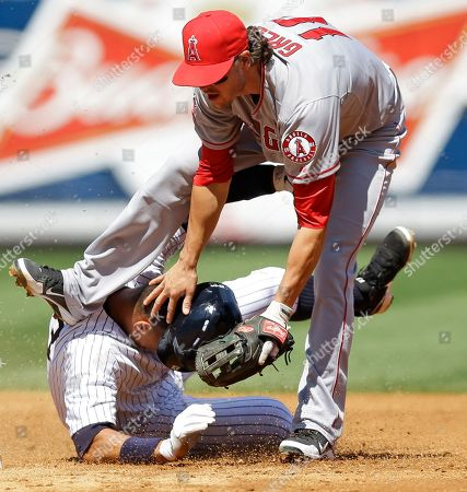 Grant Green, Alex Rodriguez Los Angeles Angels second baseman Grant Green (10) gets tangled up after forcing out New York Yankees Alex Rodriguez on an inning-ending double play hit into by Vernon Wells in the third inning of a baseball game, in New York