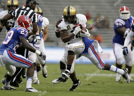 Lawrence Scott, Kentrell Brice, Lloyd Grogan Army running back Lawrence Scott (20) finds running room as Louisiana Tech defensive back Kentrell Brice (23) and Lloyd Grogan, rear, attempt the stop in the half of an NCAA college football game, in Dallas