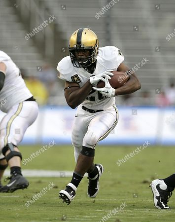 Lawrence Scott Army running back Lawrence Scott (20) finds an opening against Louisiana Tech during the first half of Lan NCAA college football game, in Dallas. Army won 35-16