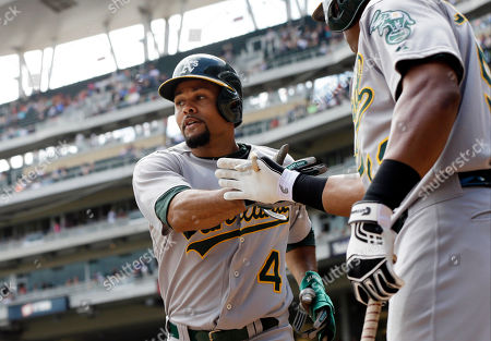 Coo Crisp Oakland Athletics' Coco Crisp, left, is congratulated by Yoenis Cespedes after scoring on a single by Jed Lowrie off Minnesota Twins pitcher Scott Diamond in the third inning of a baseball game, in Minneapolis