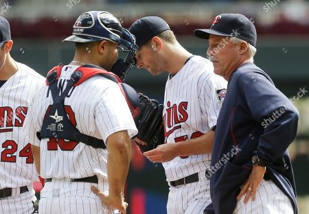 Josmil Pinto, Rick Anderson, Scott Diamond Minnesota Twins pitcher Scott Diamond, center, gets a visit by pitching coach Rick Anderson, right, and catcher Josmil Pinto after giving up a run on a RBI single by Oakland Athletics' Jed Lowrie in the third inning of a baseball game, in Minneapolis