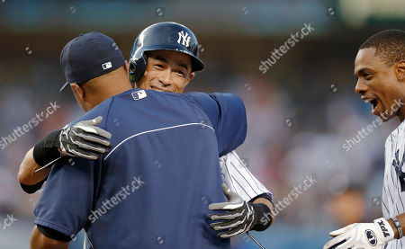 Vernon Wells, Ichiro Suzuki, Curtis Granderson New York Yankees' Vernon Wells, left, embraces teammate Ichiro Suzuki as Yankees' Curtis Granderson smiles after Suzuki hit a first-inning single for his 4,000 career hit in Japan and the major leagues, in a baseball game against the Toronto Blue Jays at Yankee Stadium, in New York