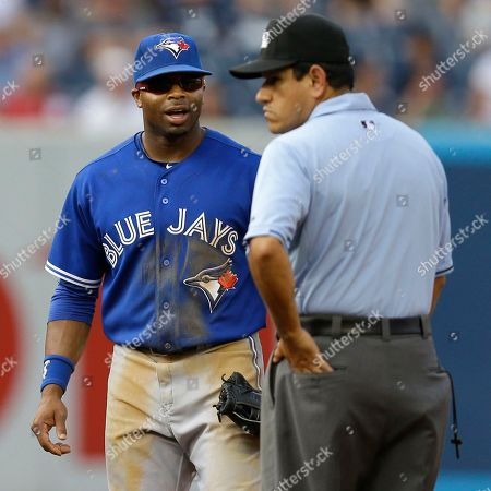Rajsi Davis, Alfonso Marquez Toronto Blue Jays center fielder Rajai Davis, left, questions second base umpire Alfonso Marquez after New York Yankees Vernon Wells reached on a fly ball fielder's choice in a baseball game at Yankee Stadium, in New York