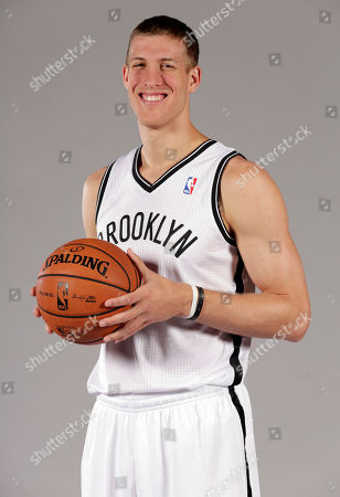 Mason Plumlee Mason Plumlee poses for photos during the Brooklyn Nets media day, at the Barclay's Center, in New York