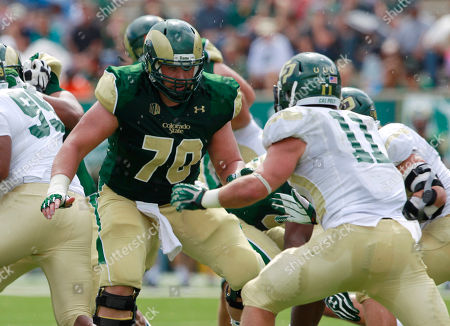 Stock Image of Weston Richburg, Johnny Millard Colorado State center Weston Richburg, left, looks to block Cal Poly linebacker Johnny Millard in the first quarter of a college football game in Fort Collins, Colo., on