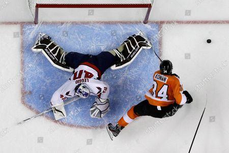 Stock Photo of Matt Konan, David Leggio Washington Capitals' David Leggio, left, blocks a shot by Philadelphia Flyers' Matt Konan during the second period of a preseason NHL hockey game, in Philadelphia