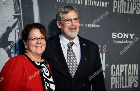 "Stock Picture of Richard Phillips, Andrea Phillips Andrea Phillips, left, and her husband Captain Richard Phillips, pose for photographers as they walk the red carpet at a screening for the movie ""Captain Phillips"" at the Newseum, in Washington"